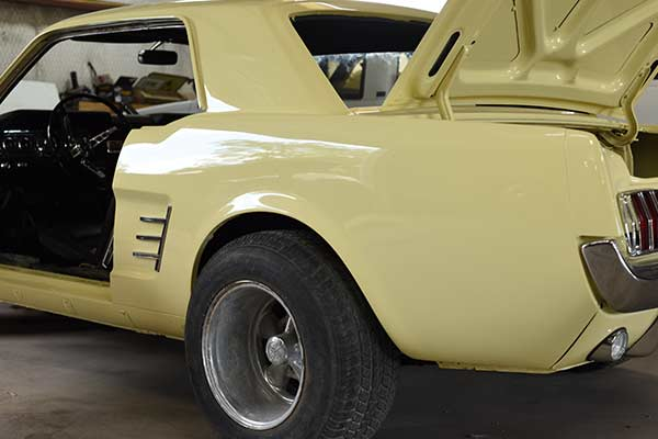 body of restored yellow Mustang car